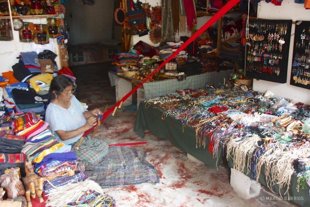 Utila woman weaving in her shop